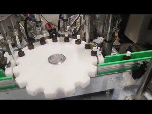 petita màquina d'ompliment d'ampolles de líquid